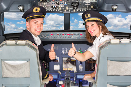 Cheap Flights Happy Pilots in the Cockpit with Thumbs Up